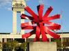 Background Control Tower And Sculpture El Sol De Edgar Negret